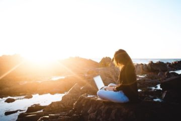 girl-sitting-on-rock-with-laptop